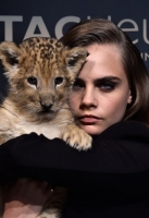 Cara Delevingne Lion Cub Photos