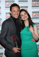 Best Male Newcomer Tom Hiddleston (L) and Hayley Atwell pose in the press room during the 2012 Jameson Empire Awards