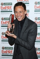 Best Male Newcomer Tom Hiddleston poses in the press room during the 2012 Jameson Empire Awards