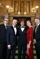 VIENNA, AUSTRIA - JULY 23:   (EDITORS NOTE: This image has been digitally manipulated) Tom Cruise (C) and members of the cast and crew pose during the world premiere of 'Mission: Impossible - Rogue Nation' at the Opera House (Wiener Staatsoper) on July 23, 2015 in Vienna, Austria.  (Photo by Andreas Rentz/Getty Images for Paramount Pictures International)