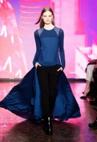 A model walks the runway at the DKNY Women's Fall 2013 fashion show during Mercedes-Benz Fashion Week on February 10, 2013 in New York City.