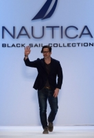 A model walks the runway at the Nautica Men's Fall 2013 fashion show during Mercedes-Benz Fashion Week at The Stage at Lincoln Center on February 8, 2013 in New York City.