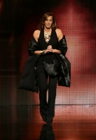 A model walks the runway at the Donna Karan New York 30th Anniversary fashion show during Mercedes-Benz Fashion Week Fall 2014 on February 10, 2014 in New York City.