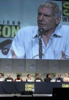 """Director J.J. Abrams, producer Kathleen Kennedy, screenwriter Lawrence Kasdan, actors Harrison Ford, Mark Hamill, Carrie Fisher, Adam Driver, Daisy Ridley, John Boyega, Oscar Isaac, Domhnall Gleeson, Gwendoline Christie, and moderator Chris Hardwick at the Hall H Panel for """"Star Wars: The Force Awakens"""" during Comic-Con International 2015 at the San Diego Convention Center on July 10, 2015 in San Diego, California."""