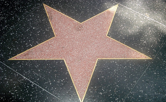 honoured with a star on the iconic Hollywood Walk of Fame in 2013 has