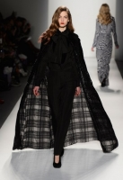 A model walks the runway at the Noon By Noor Fall 2013 fashion show during Mercedes-Benz Fashion Week at The Studio at Lincoln Center on February 8, 2013 in New York City.