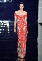 A model walks the runway at the Reem Acra fashion show during Mercedes-Benz Fashion Week Fall 2014 at The Salon at Lincoln Center on February 10, 2014 in New York City.